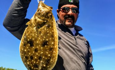 flounder caught while fishing bay to bay charters anna maria island
